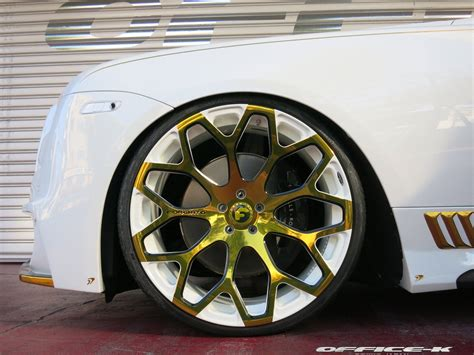 White Rolls-Royce Wraith with Gold Accents from Office-K